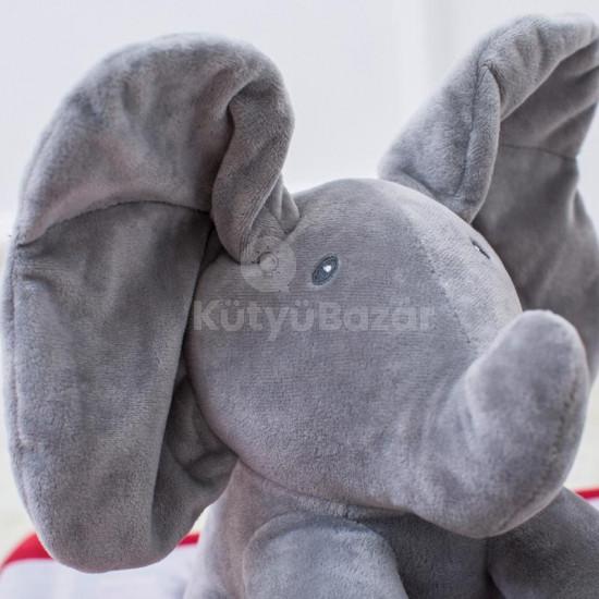Zenélő plüss elefánt