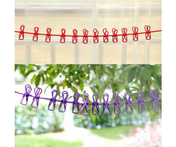 Gumis ruhaszárító kötél csipeszekkel
